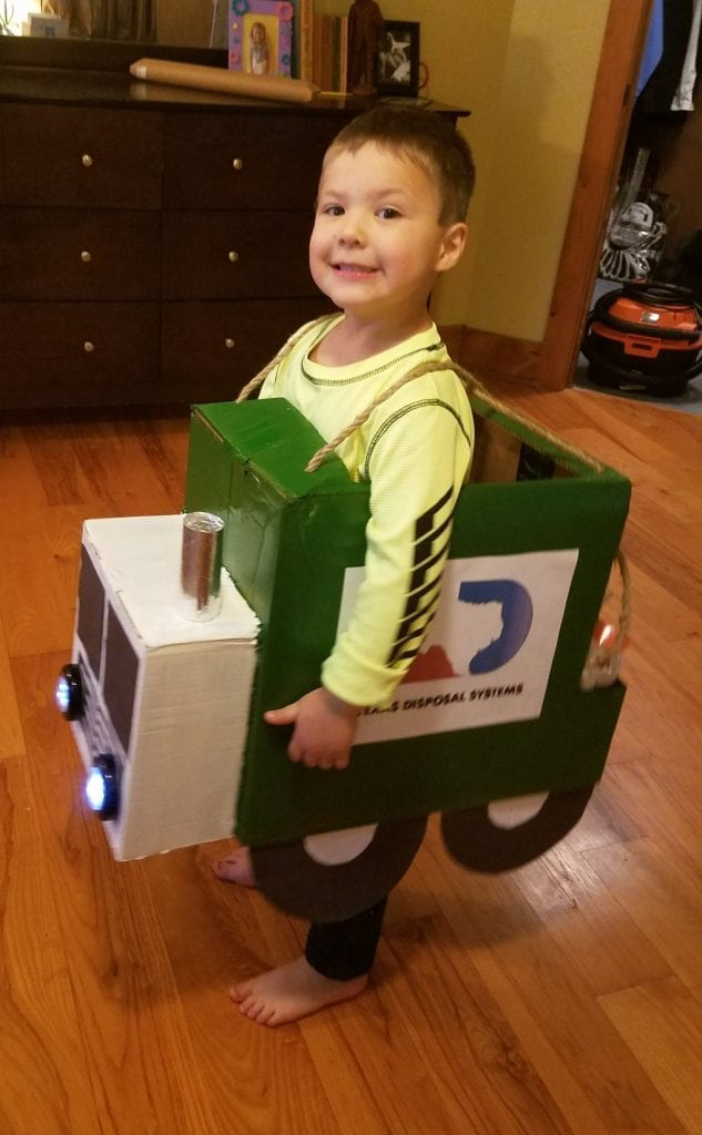 child in a DIY garbage truck costume